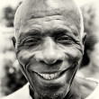 Stock Photo: Smiling old mfrom Togo