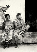 Two women from Togo watch the dancing show — Stock Photo