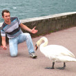 Royalty-Free Stock Photo: Young man against goose in Switzerland