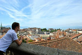 Young boy looks at Lausanne from above — Stock Photo