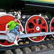 Boy poses on railway wheels — Stock Photo #12190182