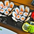 Sushi with salmon offered with ginger and wasabi — Stock fotografie