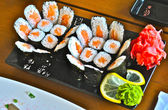 Sushi with salmon offered with ginger and wasabi — Stock Photo