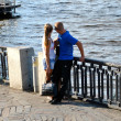 Young couple near river — Stock Photo #12265875