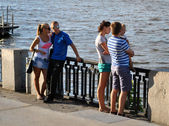 Big family near the river — Stock Photo