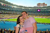Couple in love on the football match of EURO 2012 Italy against England in Kiev — Stock Photo