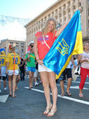 Young girl with the Ukrainian flag in her hands during EURO 2012 — Stock Photo