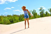 Alone sexual girl in a desert — Stock Photo