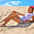 Young sexy model poses over the sand — Stock Photo #12356253