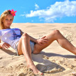Sexual girl poses on the sand — Stock Photo