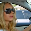 Stock Photo: Young blond in sun glasses girl drives
