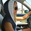 Fashion girl drives in sun glasses — Stock Photo