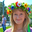 Young Ukrainian girl in a flower wreath — Stock Photo