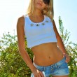 Beautiful sexy blond model show her sexuality wearing jeans shorts — Stock Photo #12382084