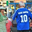 Old Ukrainian man wears football shirt of Dynamo Kyiv, with the inscription Ricky Martin - Stock Photo