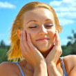 Portrait of a young very sexual blond girl which poses on a shiny day - ストック写真