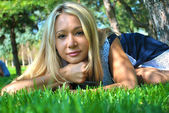 Beautiful sexual blond girl on the green grass — Stock Photo