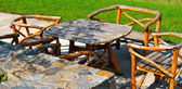 Old fashion wooden chairs and table — Stock Photo