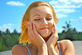 Portrait of a young very sexual blond girl which poses on a shiny day — Stock Photo