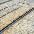 Tramway railways in Ukraine built in the old stone road — Stock Photo #12408568