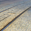 Tramway railways in Ukraine built in the old stone road — Stock Photo #12408570