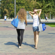 Two girls walk to the training session — Stock Photo