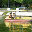 Stock Photo: Take walk on water cycles on lake in park