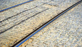 Tramway railways in Ukraine built in the old stone road — Stock Photo
