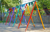 Children swing in the park named after colonel Chkalov in Dnipropetrovsk, Ukraine — Stock Photo