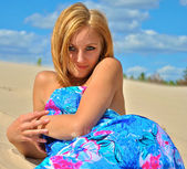 Portrait of a very beautiful pretty sexy half naked blond girl poses on the sand — Stock Photo