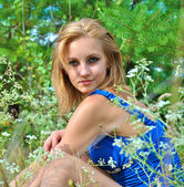 Beautiful blond female model in the grass — Stock Photo