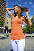 Red-haired model poses in the city — Stock Photo