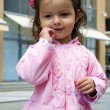 Little baby girl in a pink jacket — Stock Photo