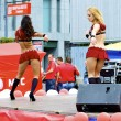 Two Russian sexy girls dance in red clothes during the city holiday and promotion of new brand — Stock Photo #12621952
