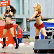 Two Russian sexy girls dance in red clothes during the city holiday and promotion of new brand — Stock Photo #12621958