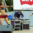 Sexual moves of two Russian sexy girls who dance in red clothes during the city holiday and promotion of new brand — Stock Photo #12621966