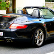 Black Porsche Carrera 4S - Stock Photo