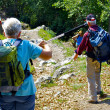 Tourists explore mountains with sticks — Stok Fotoğraf #12655557