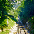 Rails go down mountain — Stock Photo #12656044