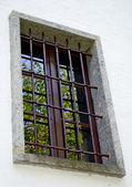 Old window with grate — Stock Photo