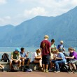 Tourists in front of the Swiss mountain — Stock Photo