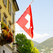 Swiss flag on the building — Stock Photo