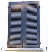 Shut window on the white wall — Stock Photo