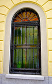 Window with grates on the building — Stock Photo