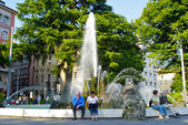 Central fountain in a Swiss city — Stock Photo