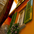 Beautiful decorative window on the orange building - Stock Photo