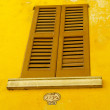 Window on yellow building — Stok Fotoğraf #12719911