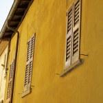 Window on the yellow building — Stock Photo