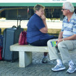 Stock Photo: Old couple wait for train