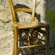 Stock Photo: Old broken chair near the house of the town on the mountain hill called Gandria, Switzerland